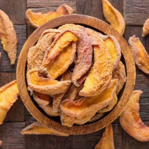 dried peaches in wooden bowl